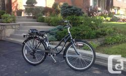 Women's 7-Speed cruising bicycle in dark blue. It is 2 years old and in excellent condition. Sale includes: Schwinn adjustable helmet, Schwinn frame pump, cable lock with two keys and owner's manual in French and English. It's a smooth and sturdy ride