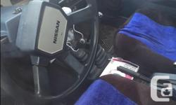 Make Nissan Year 1987 Colour black Trans Manual kms 216000 Great little fun truck that's able to help with chores and projects...just came back from Winnipeg with it....hauled a riding lawn mower there with ease. I am looking for a truck with a full size
