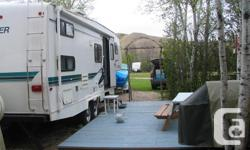 5th wheel camper. Bedroom with a queen size bed in front. Kitchen and couch in the middle. Slide out has a bench seat table with a sky light. Two bunks and bathroom is in the back, includes tub and shower. Both couch and the table make into extra beds.