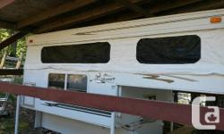 Like New Condition! Protected undercover storeage. Features include: overhead storage cabinet, porta-potty storage, three-burner cook top, under bed storage, wheel-well access doors, upgraded mattress, outside shower, L-shaped dinette, and more. Takes
