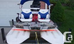 2008 CraigCat E2 ELITE The queen of the CraigCat ® fleet, it's the top-of-the-line, high-performance model loaded with all the most well-liked devices. Perfect balance of precision aquatic handling and ergonomic comfort. Full of attributes and long on