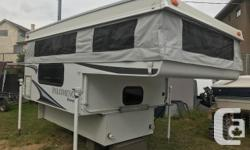 """2010 PALOMINO BRONCO 1200 FOREST RIVER LIKE NEW Year: 2010 Make: Palomino Series: Bronco Model: 1250 Length: 12' 10"""" Side Dinette Empty Weight: 1,395 lbs. Fresh Water: 16 gal. Condition: Excellent Interior Color: Brown Exterior Color: White FRIDGE HOT"""
