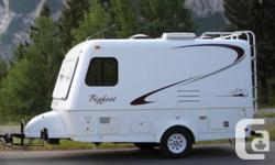 This Bigfoot Travel Trailer with center bathroom, features light-weight two-piece fiberglass exterior and high density insulation, along with thermal pane windows, making it an ideal multi-season towable RV. The trailer comes with the following High