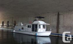 Charming Houseboat Twin Merc I/Os 225hp. Bravo1 enginesHouse structure and steel bottom all renewed in 2008 including anti-corrosion coating,Located on the Ottawa River.Survey 2013New water heaterKohler generator (7.5 kw)Electric ignition Depth finderNew