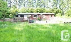 Property Type: Single Family Building Type: House Title: Freehold Land Size: 2.02 ac Any Parking Spaces: 2  Very private acreage North of Duncan. 3 bedroom home and detached shop with beautiful suite set on 2 acres bordering the creek. The rancher has fir