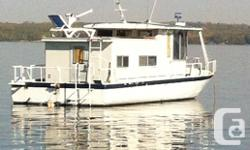 Very versatile river boat style houseboat. Steel hull laid in 1966, deck house rebuilt in 1993. Built in generator that operates with the touch of a switch. two bunks in a separate bedroom, full bathroom, kitchen and fold down bed. Handles beautifully.
