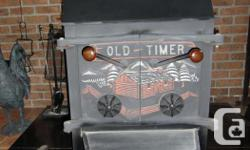 """AIR TIGHT WOOD STOVE OLD TIMER FOR HUNTING &FISHING CABIN SHED OR GARAGE 23"""" W IDE --21"""" DEPTH--33"""" HEIGHT"""