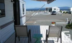 Envision seeing eagles soaring, cruise liner passing by, and appreciating incredible sunsets from the deck of your very own villa! Surfside RV Resort is a beautiful Five-Star gated area with facilities for everyone-- a huge clubhouse, washing properties,