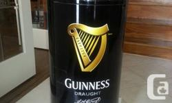 Brand new Guinness Beer Fridge Dispenser.   Have your cans of beer always refreshingly cold inside this one-of-a -kind promotional fridge. Not in stores!!  From the pictures you can see that the front opens like a door to load all the cans. It uses a