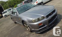 Make Nissan Model GT-R Year 1999 Colour WHITE kms 97728 FOR SALE CAR IS IN MONTREAL 2- R34 GTR Vspec 1- EVO 6 1- S15 SILVIA 1- EVO 5 1 - S13 SILVIA 1- R34 GTT 1- SUPRA SINGLE TURBO 1-SUPRA NON TURBO 5 SPEED 2-R33 GTR WE CAN SHIP CAR ALL AROUND CANADA FOR