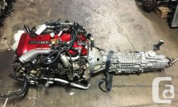 JDM NISSAN SKYLINE GTR RB26DETT R34 MOTOR WITH 6 SPEED GETRAG MT TRANSMISSION FOR SALE call us for the price COMPLETE ENGINE AS SHOWN IN THE PICTURES HEAD AND BLOCK INTAKE AND EXHAUST MANIFOLD COILS ALTERNATOR POWER STEERING PUMP ECU HARNESS TURBOS COMES