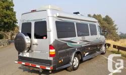 Fantastic RV/Camper Van in a beautiful fuel efficient Diesel Mercedes Sprinter Van Chassis. Fully outfitted with full galley/kitchen, with fridge (gas, 12v or 110v), propane double burner stove and sink. Power Sofa at rear changes to a queen size bed with