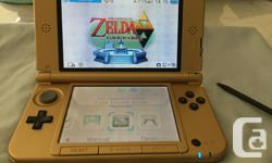 The Legend of Zelda A Link Between Worlds Limited Edition Nintendo 3DS XL. Impeccable condition-- no scratches or scuffs on either the outer casing or screen. Comes complete with stylus, charger, manuals and five games (Zelda: A Link Between Worlds,