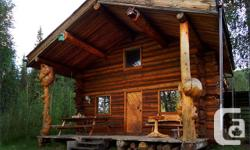 Spectacular Riverfront Views from the Porch and Balcony of this Fabulous Log Cabin w/Loft on 8.5 Acres at Cassiar Creek, 1 and a half hours down the Yukon River from Dawson City by boat or snowmobile. Live like a Sourdough during the Klondike Gold Rush,