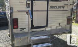 """Security Penthouse 99 Camper�1994�These Okanagan built units are considered to be 'Cadillac' campers and are very hard to find. This unit is 11' 5"""" and in very good shape. Lots of nice features including a custom-made porch worth $1500 plus brand-new"""