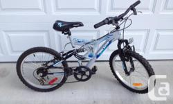 """Boys Savage 2.0 Mountain Bike. 20"""" wheels, 16"""" frame, full front & rear suspension, Shimano 6 speed gears. Always stored indoors, very good overall condition. Outgrown too soon, hardly ridden. Ages 7-10 Shows some wear on rear tire. $90.00 obo"""
