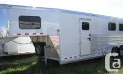 """2+1 GN, THE ULTIMATE IN HAULING LARGE HORSES!! 2 - 6000# Rubber torsion axles with ultralube hubs four Wheel electric brakes 5 - 235/85R16 Load Range""""E"""" ten ply radial tires eight Bolt Silver modular mag wheels, 2 5/16"""" coupler w/adjustable height stem,"""