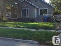 Stunning, spacious home in the heart of St. Vital. Big
