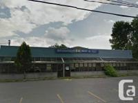 Big business structure over 11 400sq ft with a paved