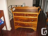 Really beautiful dresser with towel racks on both