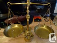 I am offering an antique Brass scale that is complete