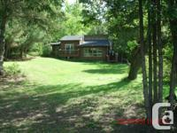 This four-season, 7 area house on Shadow Lake in the