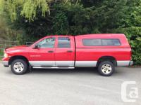 5.7 HEMI. Tons of power and really good mileage (for a