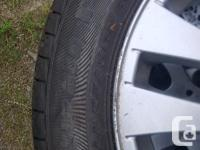 New tires on BMW 325xi wheel. The tire only have 100 km