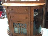 Lovely rounded glass, two cabinet China Cabinet. Claw