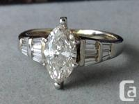 Gorgeous diamond engagement ring. The center is a