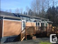 #112-This 1 bedroom previously owned park model backs