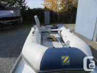 10' Zodiac on tilt trailer with cover & new chair.