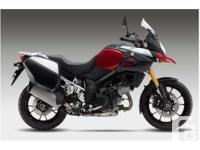 Equipped with saddlebags, handguards & adjustable