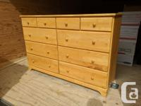 This lovely dresser is made out of solid wood (parawood