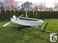 Up for sale is a 10' fiberglass boat and trailer