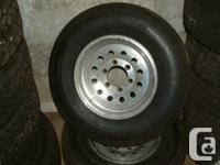 pair of aluminum rims from a Raptor Toy hauler trailer,