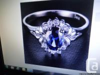 This is a beautiful deep blue Sapphire ring with White