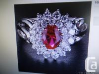 This is an elegant red Ruby ring in 14K white gold