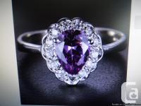 This is a very pretty deep purple Amethyst ring with