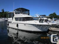 This impeccable Carver 390 Aft Cabin is very well cared