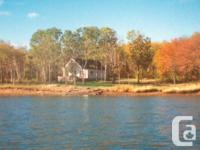 Serene, private, 2.2 acre waterfront property located