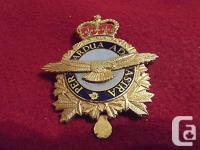 A Canadian Forces Queens Crown Cap Badge To The Air