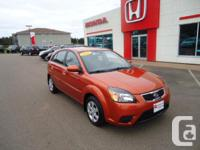 Make. Kia. Model. Rio5. Year. 2011. Colour. Orange.