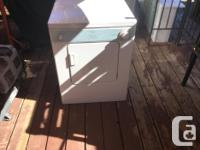 Washer in great working condition, has kitchen sink