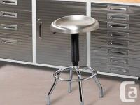 The stainless steel-top work stool features a