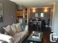 870 sq ft 2 Bedroom condo with a timber burning fire