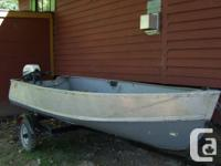 This aluminum boat is 12 feet long.  The motor is 5 hp