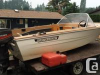 12 foot Hourston Glascraft fiberglass deep V boat with