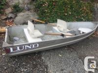 12 foot lund alum boat with oars , has 3 seats, bone