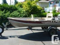 Lund wc12 aluminum boat on a Road jogger trailer.